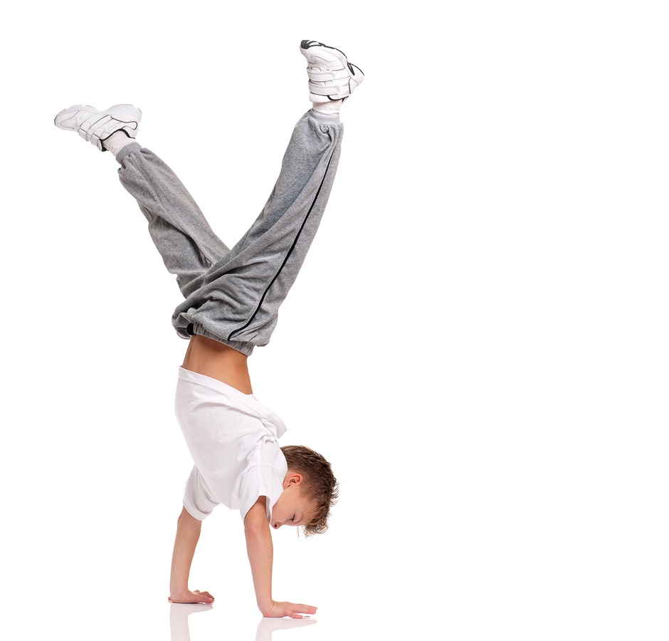 Happy Little Boy Gymnastic Acrobatics Equilibrium Posture Isolated On White Background